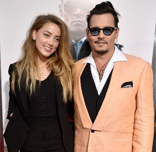 Hậu chia tay, Johnny Depp sửa hình xăm tên Amber Heard thành đồ cặn bã - Ảnh 3.