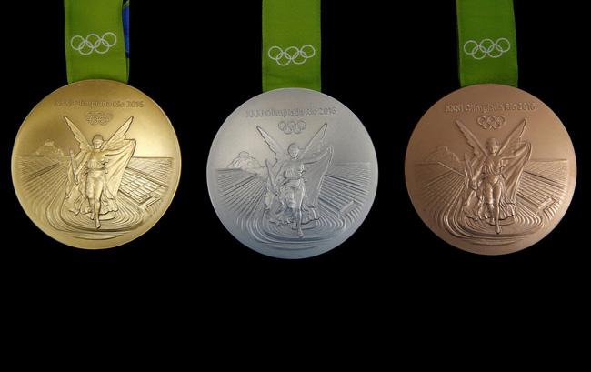Sắp tới Olympic Rio rồi, có ai thắc mắc người ta đúc huy chương như nào không? - Ảnh 23.