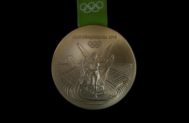 Sắp tới Olympic Rio rồi, có ai thắc mắc người ta đúc huy chương như nào không? - Ảnh 24.