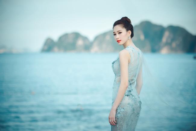 Hoa hậu Thu Thảo khoe vẻ đẹp mong manh, thoát tục trước biển Hạ Long - Ảnh 5.